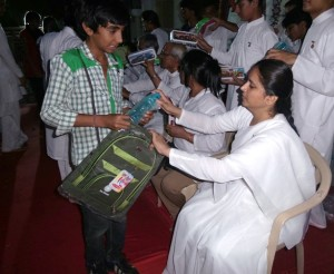 BK Ishitaben Distributing Gifts to Divya Nagari Children